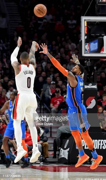 Damian Lillard of the Portland Trail Blazers hits a shot over Paul George of the Oklahoma City Thunder during the second half of the game at the Moda...