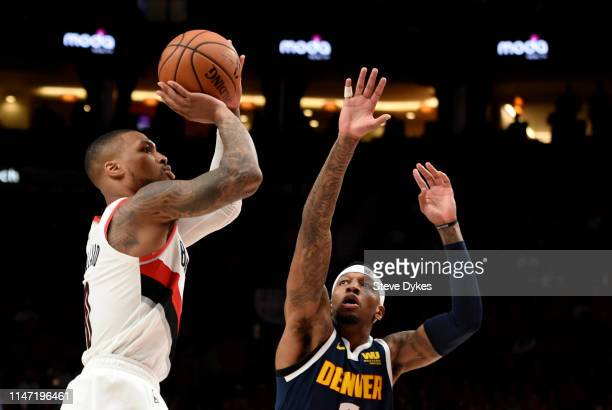 Damian Lillard of the Portland Trail Blazers hits a shot over Torrey Craig of the Denver Nuggets during the first half of game four of the Western...