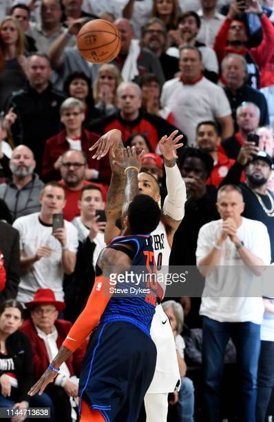 Damian Lillard of the Portland Trail Blazers hits the game winning shot in Game Five of the Western Conference quarterfinals against the Oklahoma...