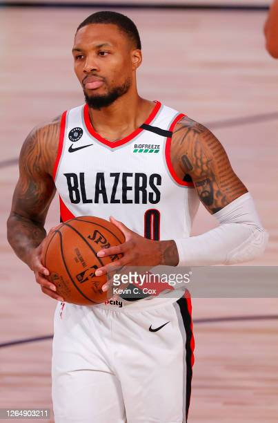 Damian Lillard of the Portland Trail Blazers holds the ball against the Philadelphia 76ers at Visa Athletic Center at ESPN Wide World Of Sports...