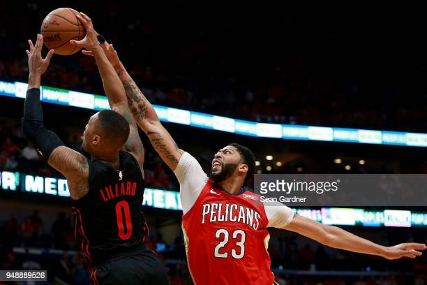 Damian Lillard of the Portland Trail Blazers is fouled by Anthony Davis of the New Orleans Pelicans during Game 3 of the Western Conference playoffs...