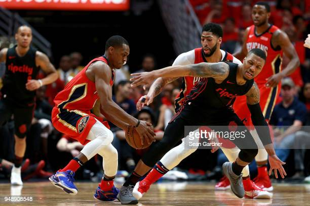Damian Lillard of the Portland Trail Blazers is fouled by Rajon Rondo of the New Orleans Pelicans during Game 3 of the Western Conference playoffs...
