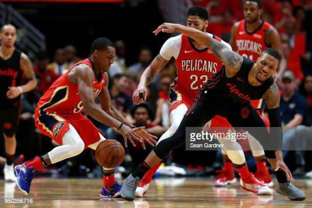 Damian Lillard of the Portland Trail Blazers is fouled by Rajon Rondo of the New Orleans Pelicans during Game 3 of the Western Conference playoffs at...