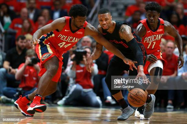 Damian Lillard of the Portland Trail Blazers is fouled by Solomon Hill of the New Orleans Pelicans during Game 3 of the Western Conference playoffs...