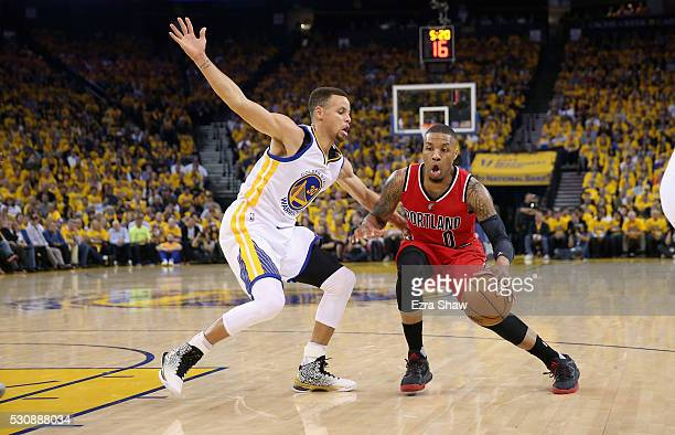 Damian Lillard of the Portland Trail Blazers is guarded by Stephen Curry of the Golden State Warriors during Game Five of the Western Conference...