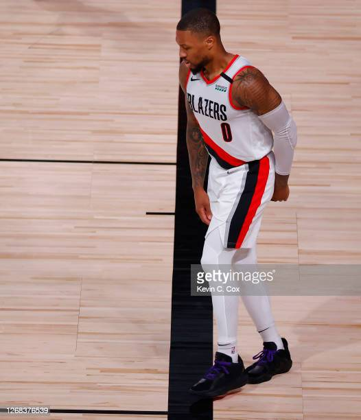 Damian Lillard of the Portland Trail Blazers limps after drawing a foul against the Los Angeles Lakers during the third quarter in Game Four of the...
