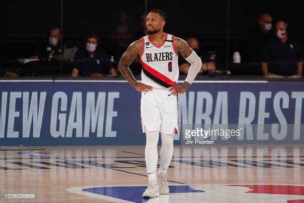 Damian Lillard of the Portland Trail Blazers looks on against the Brooklyn Nets as part of the NBA Restart 2020 on August 13, 2020 at Visa Athletic...