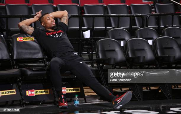 Damian Lillard of the Portland Trail Blazers looks on before the game against the Golden State Warriors on March 9 2018 at the Moda Center in...