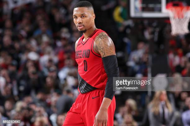 Damian Lillard of the Portland Trail Blazers looks on during game against the Houston Rockets on December 9 2017 at the Moda Center in Portland...