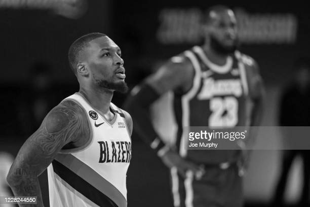 Damian Lillard of the Portland Trail Blazers looks on during the game against the Los Angeles Lakers during Round One Game Three on August 22 2020 in...