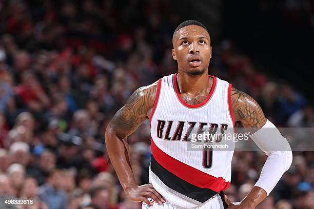 Damian Lillard of the Portland Trail Blazers looks on during the game against the Detroit Pistons on November 8 2015 at the Moda Center in Portland...