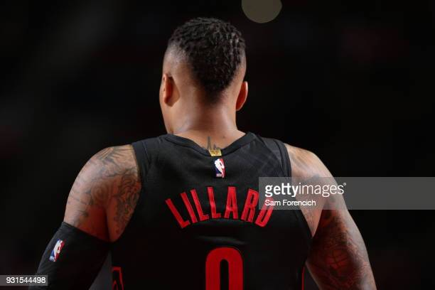 Damian Lillard of the Portland Trail Blazers looks on during the game against the Golden State Warriors on March 9 2018 at the Moda Center Arena in...
