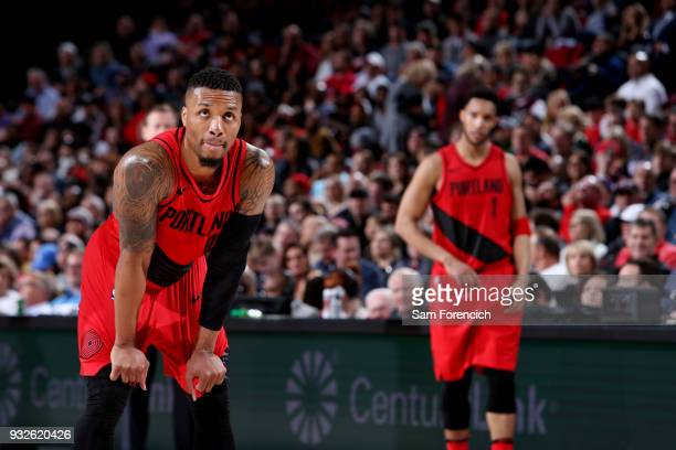 Damian Lillard of the Portland Trail Blazers looks on during the game against the Cleveland Cavaliers on March 15 2018 at the Moda Center in Portland...
