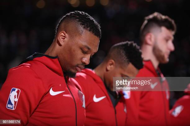 Damian Lillard of the Portland Trail Blazers looks on during the national anthem prior to the game against the Miami Heat on March 12 2018 at the...