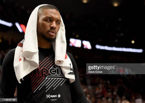 Damian Lillard of the Portland Trail Blazers looks on from the bench during a time out in the second half of Game Six of the Western Conference...