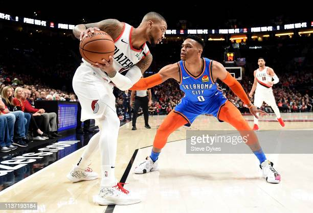 Damian Lillard of the Portland Trail Blazers looks to gets past Russell Westbrook of the Oklahoma City Thunder during the first quarter of the game...