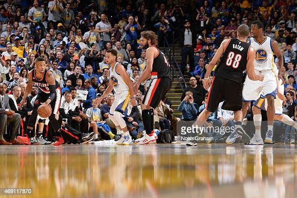 Damian Lillard of the Portland Trail Blazers looks to move the ball against the Golden State Warriors during the game on April 9 2015 at ORACLE Arena...