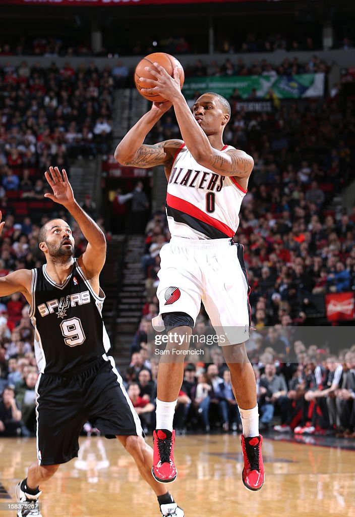 Damian Lillard #0 of the Portland Trail Blazers looks to pass the ball while guarded by Tony Parker #9 of the San Antonio Spurs on December 13, 2012 at the Rose Garden Arena in Portland, Oregon.