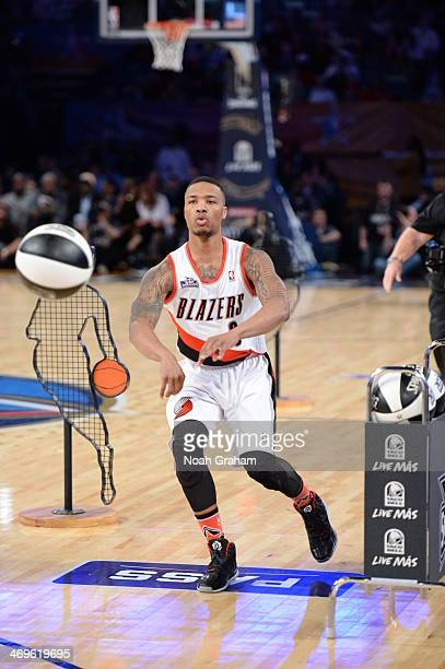 Damian Lillard of the Portland Trail Blazers makes a pass during the Taco Bell Skills Challenge on State Farm AllStar Saturday Night as part of the...