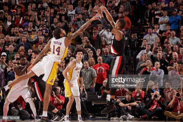 Damian Lillard of the Portland Trail Blazers makes the game winning shot against Brandon Ingram of the Los Angeles Lakers on November 2 2017 at the...