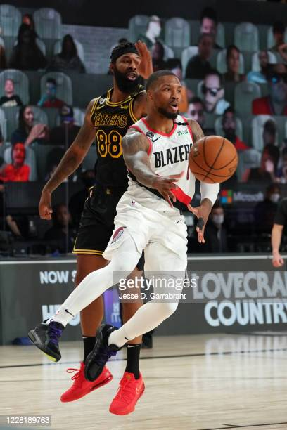 Damian Lillard of the Portland Trail Blazers passes the ball against the Los Angeles Lakers during Round One Game Four of the NBA Playoffs on August...