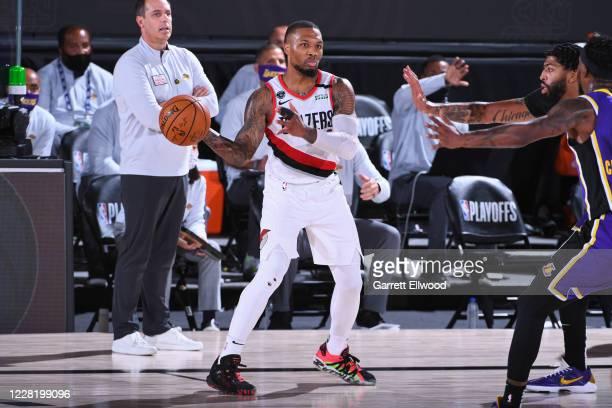 Damian Lillard of the Portland Trail Blazers passes the ball against the Los Angeles Lakers during Round One Game Three of the NBA Playoffs on August...