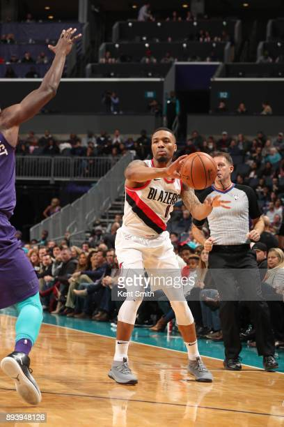 Damian Lillard of the Portland Trail Blazers passes the ball against the Charlotte Hornets on December 16 2017 at Spectrum Center in Charlotte North...
