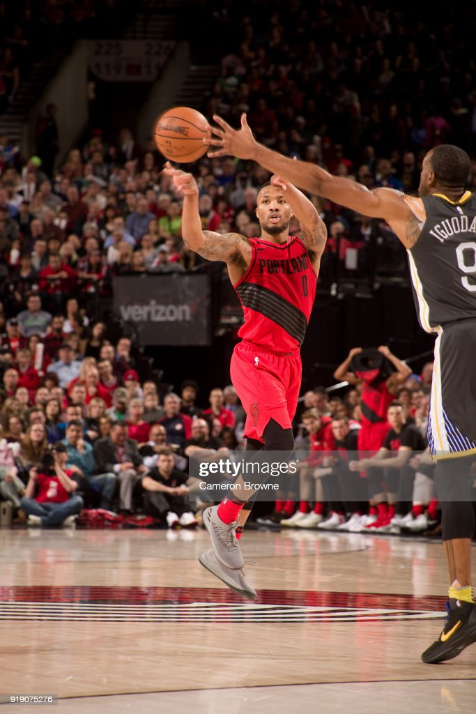 Damian Lillard #0 of the Portland Trail Blazers passes the ball against the Golden State Warriors on February 14, 2018 at the Moda Center Arena in Portland, Oregon.