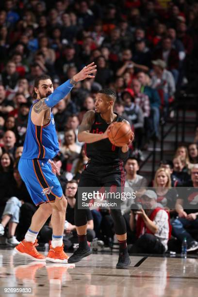 Damian Lillard of the Portland Trail Blazers passes the ball against Steven Adams of the Oklahoma City Thunder on March 3 2018 at the Moda Center in...