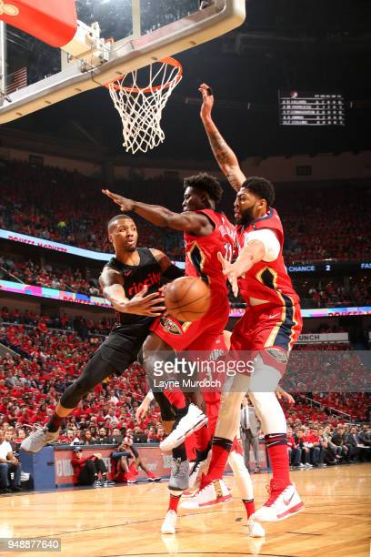 Damian Lillard of the Portland Trail Blazers passes the ball against the New Orleans Pelicans in Game Three of Round One of the 2018 NBA Playoffs on...