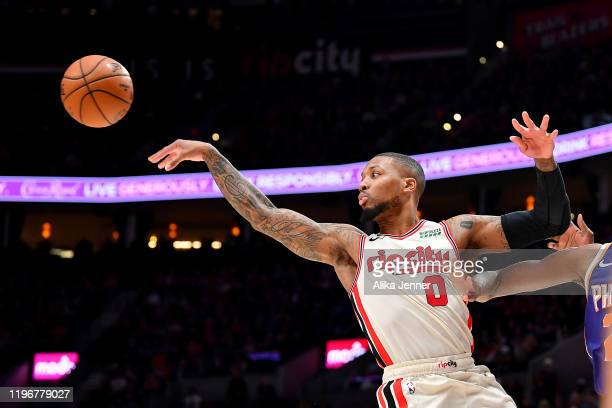 Damian Lillard of the Portland Trail Blazers passes the ball while driving to the basket during the second half of the game against the Phoenix Suns...