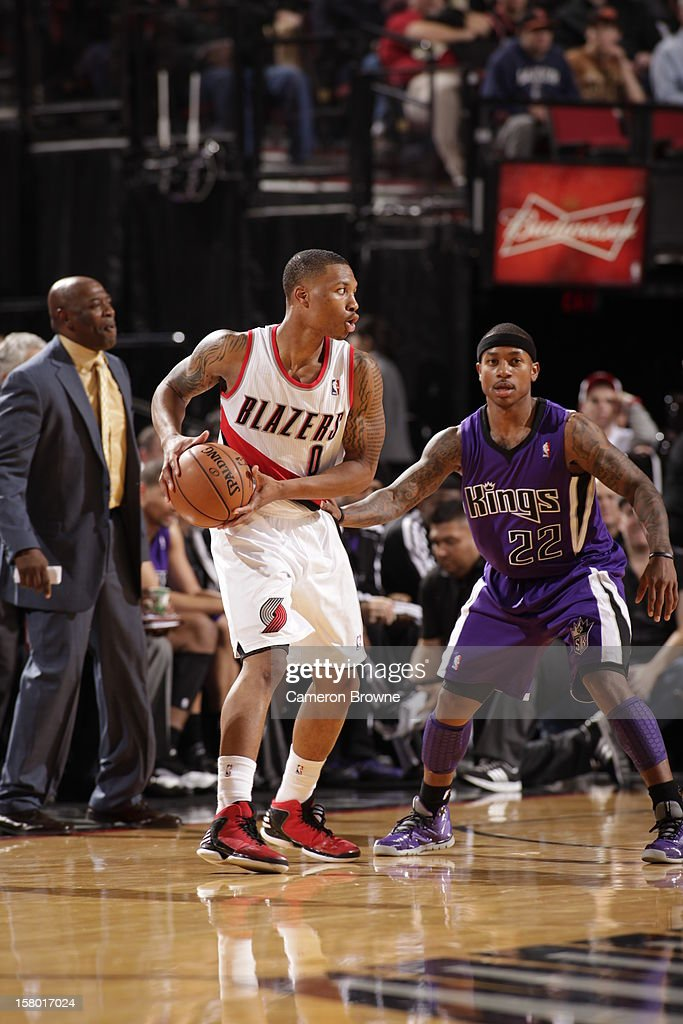 Damian Lillard #0 of the Portland Trail Blazers protects the ball from Isaiah Thomas #22 of the Sacramento Kings during the game between the Sacramento Kings and the Portland Trail Blazers on December 8, 2012 at the Rose Garden Arena in Portland, Oregon.