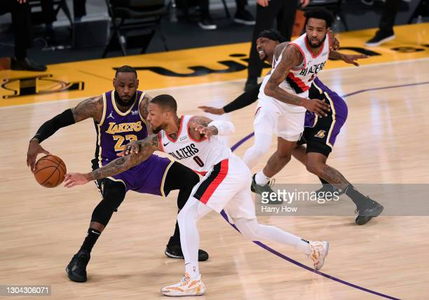 Damian Lillard of the Portland Trail Blazers reaches for the ball on LeBron James of the Los Angeles Lakers during the third quarter at Staples...