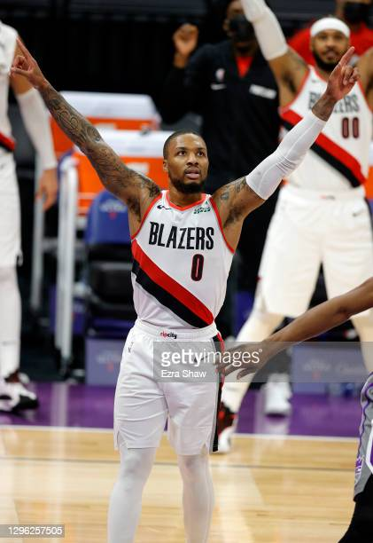 Damian Lillard of the Portland Trail Blazers reacts after CJ McCollum made a three-point basket at the end of the first half against the Sacramento...