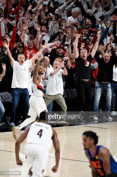 Damian Lillard of the Portland Trail Blazers reacts after hitting the game winning shot in Game Five of the Western Conference quarterfinals against...