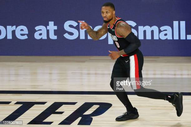 Damian Lillard of the Portland Trail Blazers reacts after making a three point basket during the second half against the Dallas Mavericks at The...