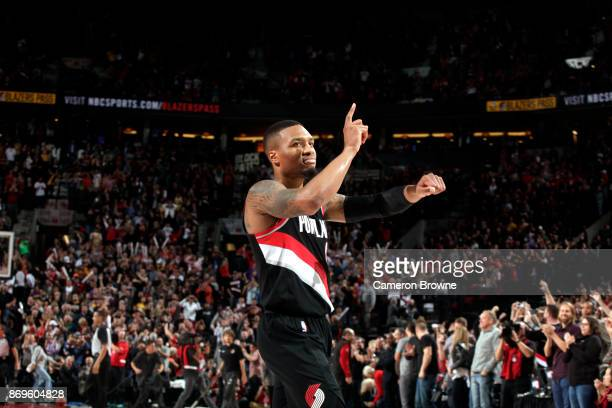 Damian Lillard of the Portland Trail Blazers reacts after scoring the game winning basket against the Los Angeles Lakers on November 2 2017 at the...