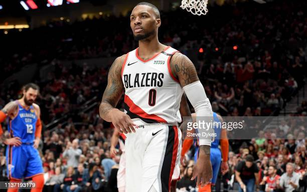 Damian Lillard of the Portland Trail Blazers reacts during play against the Oklahoma City Thunder in the first quarter at Moda Center on April 14...