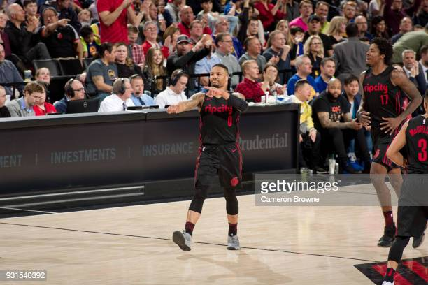 Damian Lillard of the Portland Trail Blazers reacts during the game against the Golden State Warriors on March 9 2018 at the Moda Center in Portland...