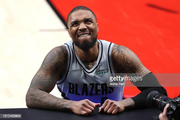 Damian Lillard of the Portland Trail Blazers reacts in the third quarter against the Boston Celtics at Moda Center on April 13, 2021 in Portland,...