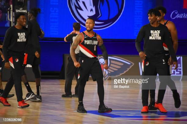 Damian Lillard of the Portland Trail Blazers reacts to a win against the Dallas Mavericks on August 11, 2020 at The Arena at ESPN Wide World Of...