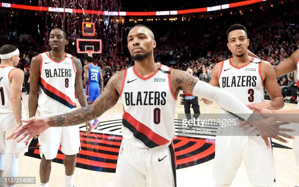 Damian Lillard of the Portland Trail Blazers reacts with his teammates after the game at the Moda Center on April 14 2019 in Portland Oregon The...