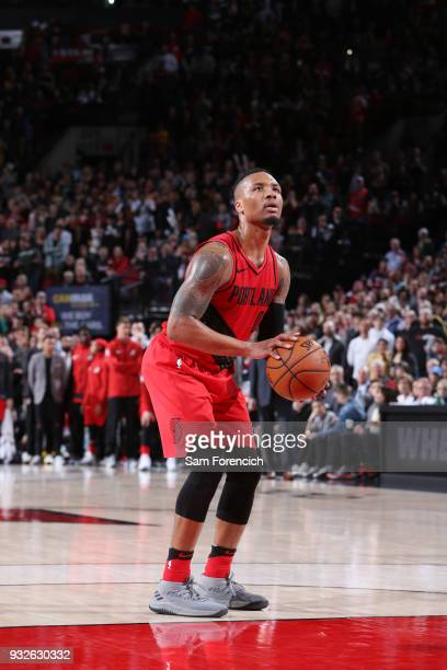 Damian Lillard of the Portland Trail Blazers shoots a free throw during the game against the Cleveland Cavaliers on March 15 2018 at the Moda Center...