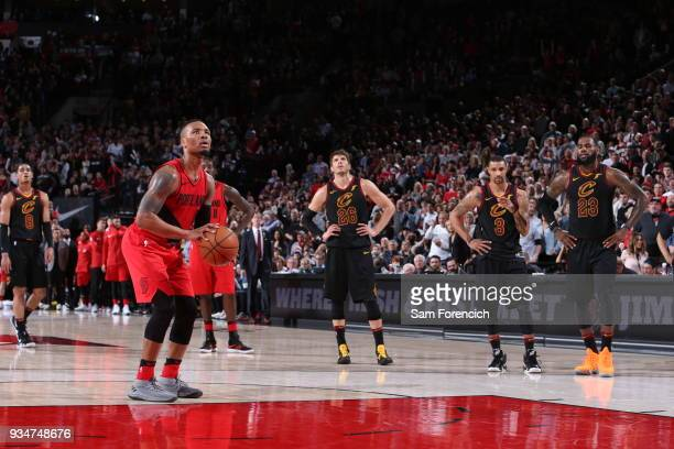 Damian Lillard of the Portland Trail Blazers shoots a free throw against the Cleveland Cavaliers on March 15 2018 at the Moda Center Arena in...