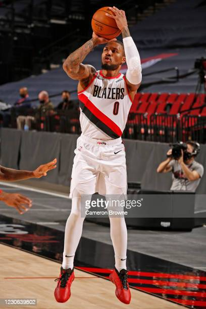 Damian Lillard of the Portland Trail Blazers shoots a three point basket against the Atlanta Hawks on January 16, 2021 at the Moda Center Arena in...