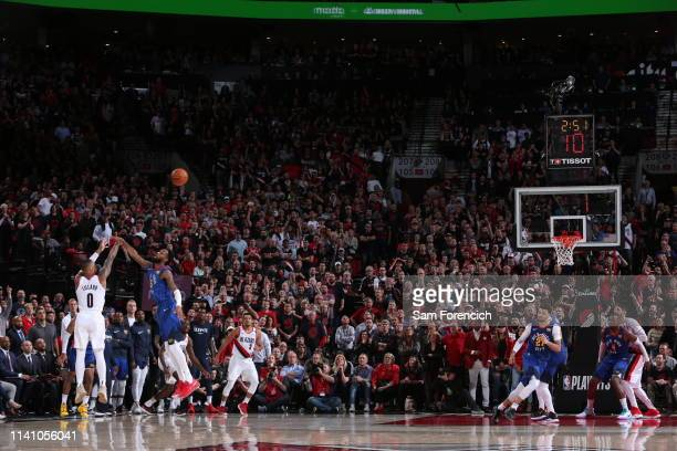 Damian Lillard of the Portland Trail Blazers shoots a three pointer in double overtime against the Denver Nuggets during Game Three of the Western...