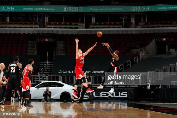 Damian Lillard of the Portland Trail Blazers shoots a three pointer to win the game against the Chicago Bulls on January 30, 2021 at United Center in...