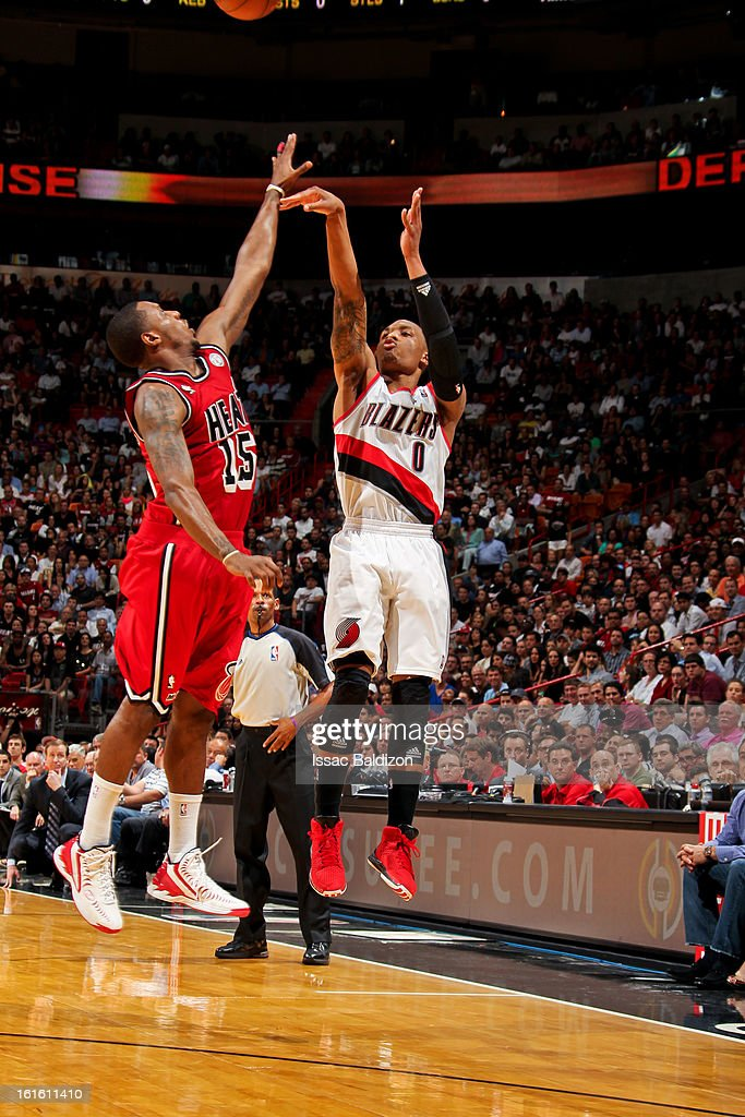 Damian Lillard #0 of the Portland Trail Blazers shoots a three-pointer against Mario Chalmers #15 of the Miami Heat on February 12, 2013 at American Airlines Arena in Miami, Florida.