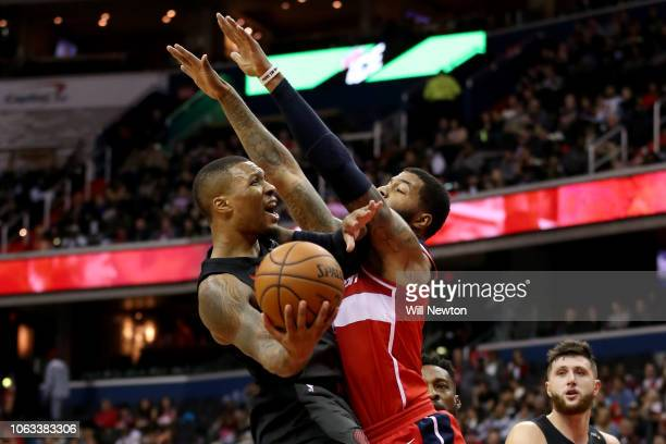 Damian Lillard of the Portland Trail Blazers shoots against Markieff Morris of the Washington Wizards during the second half at Capital One Arena on...