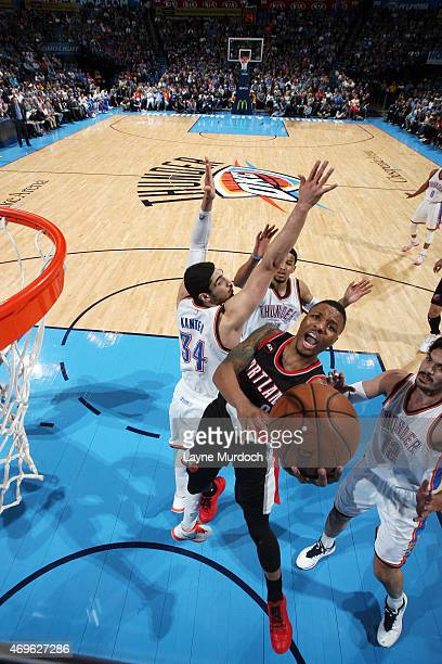 Damian Lillard of the Portland Trail Blazers shoots against the Oklahoma City Thunder on April 13 2015 at Chesapeake Energy Arena in Oklahoma City...